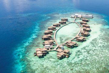 Overwater residences at the Raffles Maldives Meradhoo Resort, Maldives.