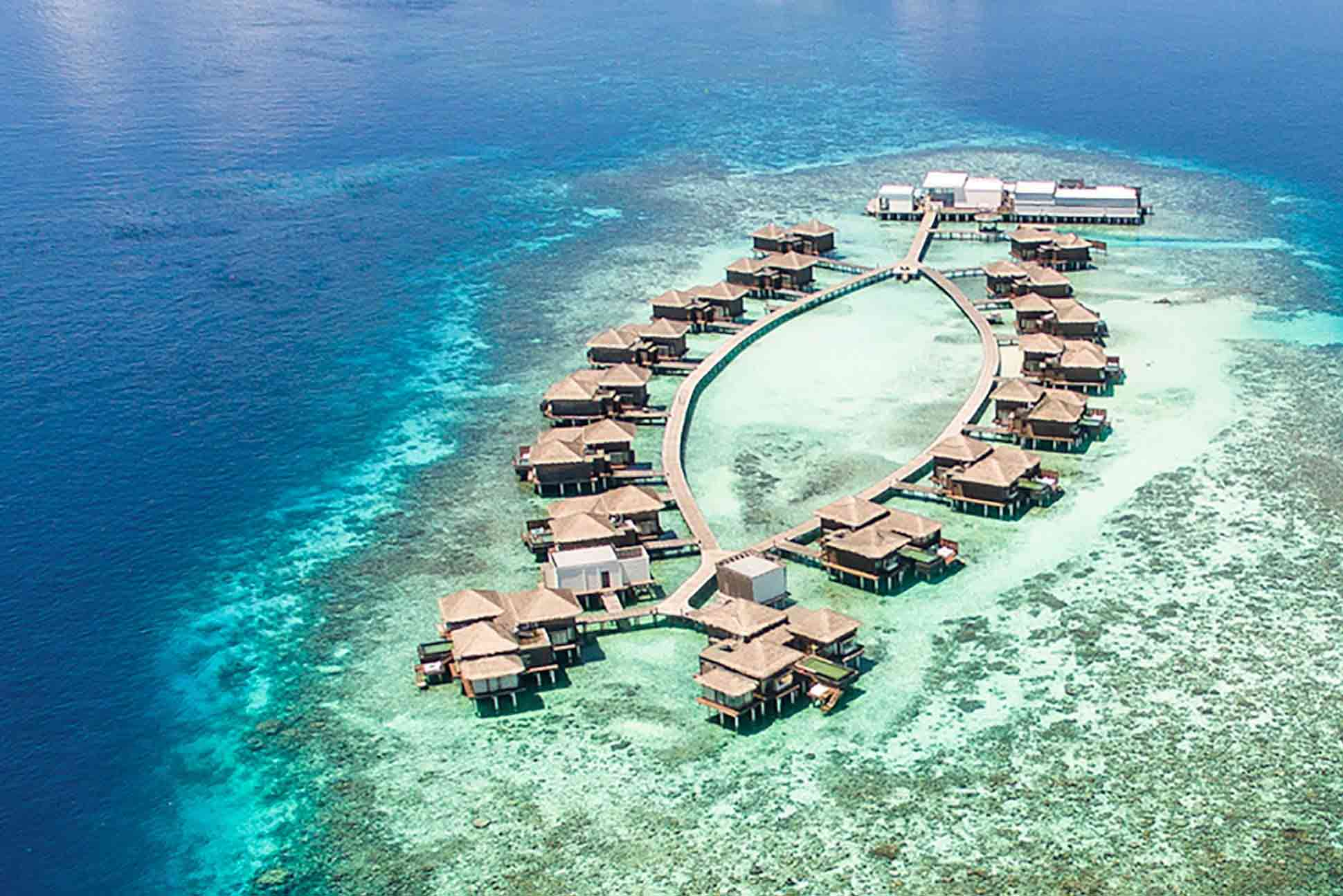 Overwater residences at the Raffles Maldives Meradhoo Resort, Maldives.