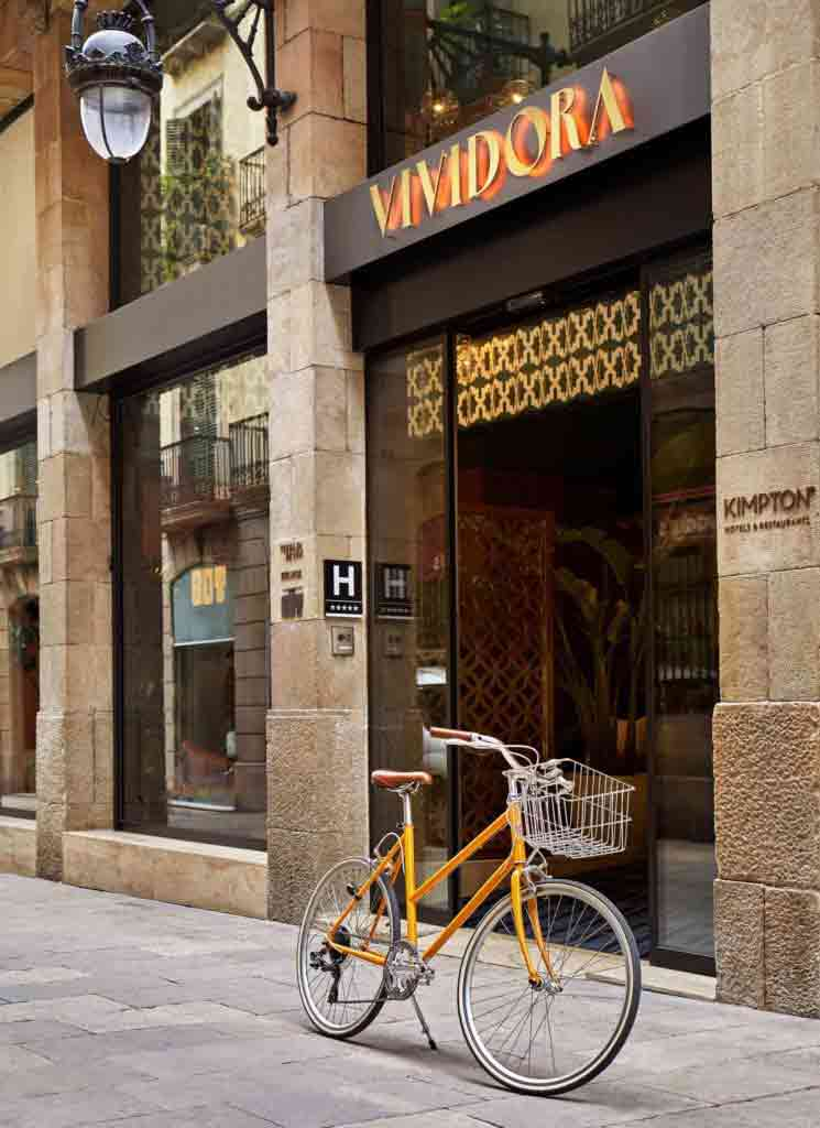 A bike outside the entrance of the Kimpton Vividora Hotel, Barcelona, Spain