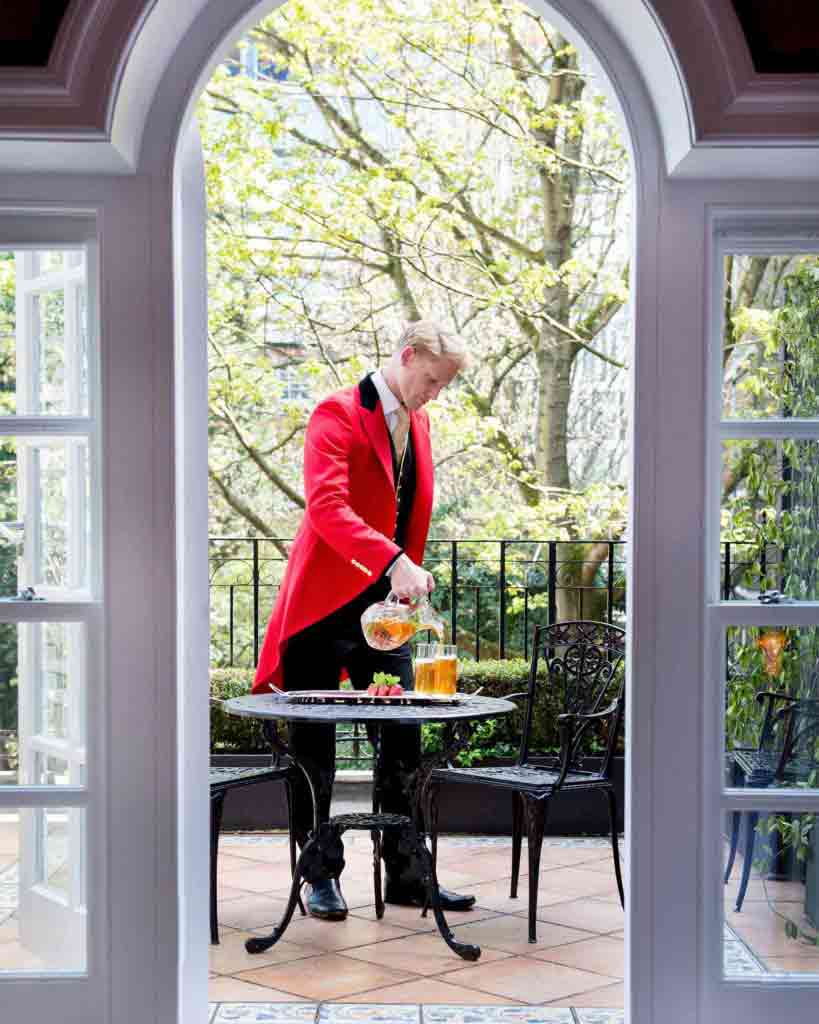 A footman serving tea at The Goring, London, United Kingdom