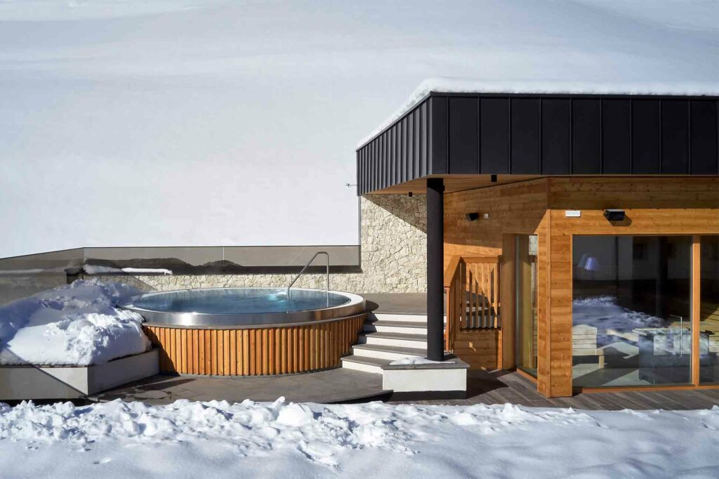 Outdoor whirlpool at Hotel Sassongher, Alta Badia, Italy