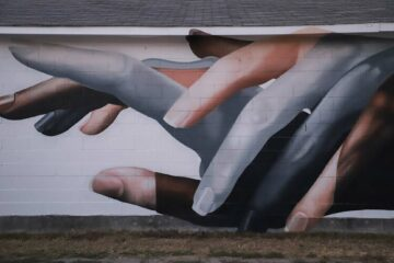 Walls of Women Tennessee murals project hands