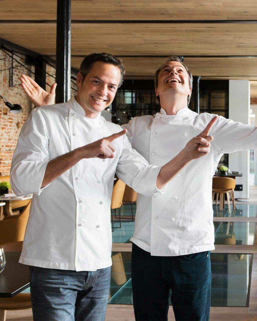 Chefs joke around at the Palacio de los Duques Gran Melia, Madrid, Spain