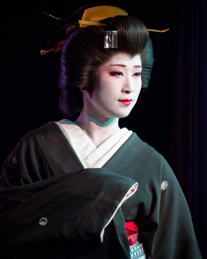 A geisha poses for a photograph in Tokyo, Japan