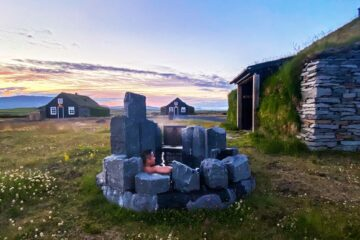 Hot tub under the midnight sun, Torfhus Retreat, Iceland