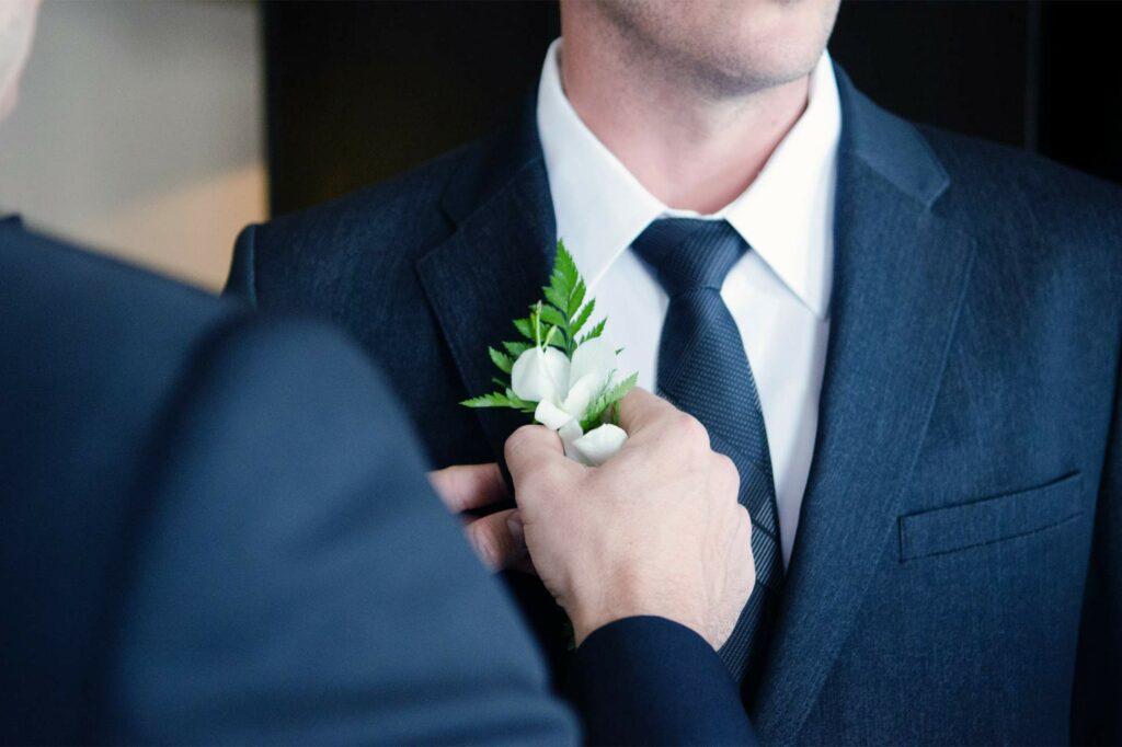Groom prepares to get married on wedding day