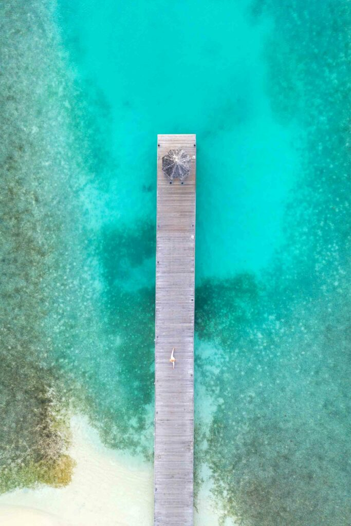 Pier over turquoise waters of Antigua