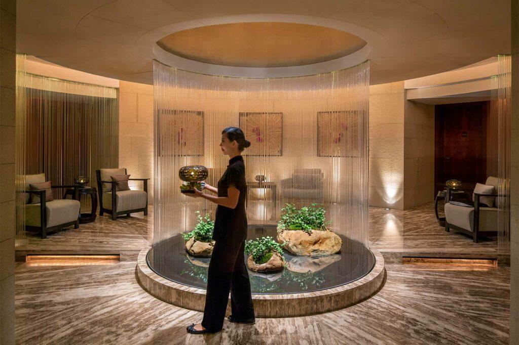 A massage therapist at The Peninsula Hong Kong spa