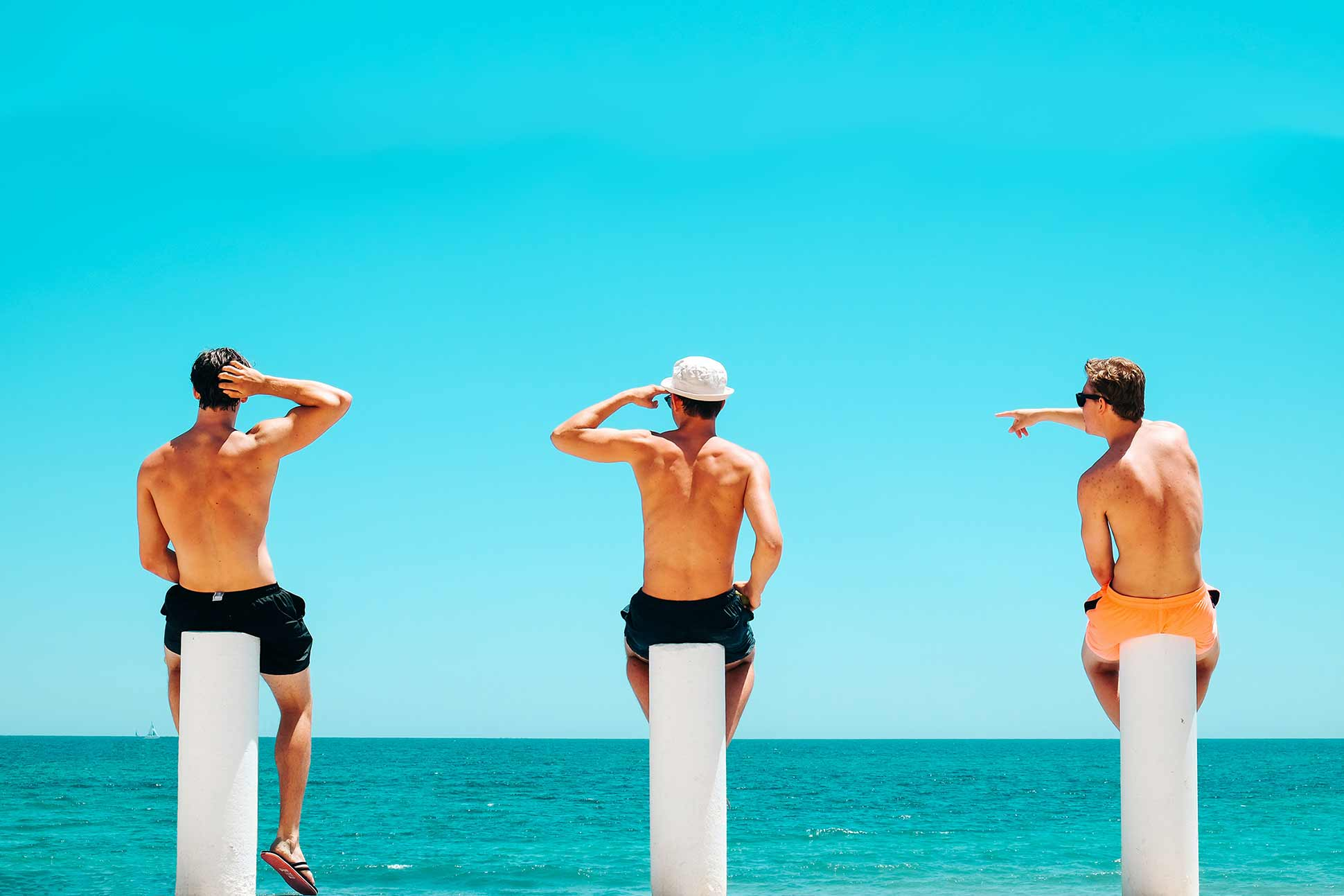Three guys on beach for the Travel & Adventure Show