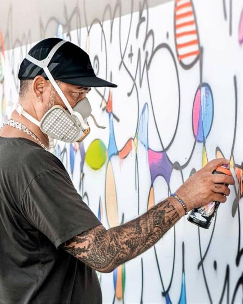 Graffiti artist Cyril Kongo at work