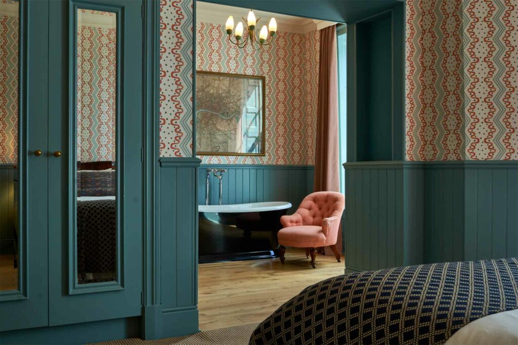 Bedroom with bathtub at The Mitre Hotel, London, United Kingdom